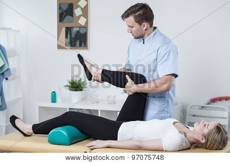 Male Physiotherapist Exercising With Patient