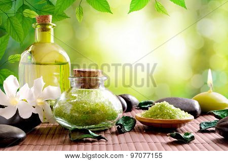Bath Salts And Body Oil On Wooden Mat