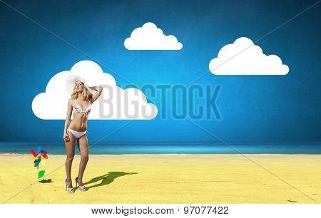 Pretty girl in white bikini and hat on summer beach