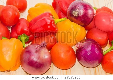 Red And Yellow Bell Peppers, Tomatoes And Red Onions Closeup