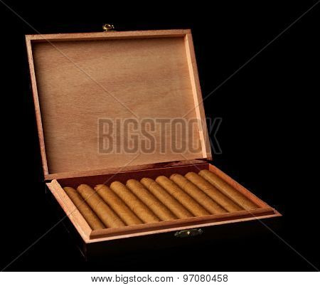 Cigars in box on black background