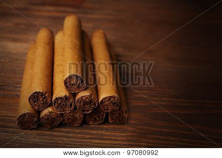 Cigars on wooden background