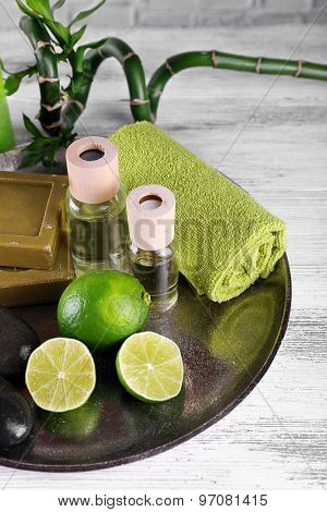 Beautiful composition of spa treatment on tray, on light background