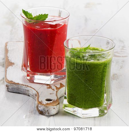 Healthy Fresh Spinach And Strawberry Smoothies On A Wooden Table.