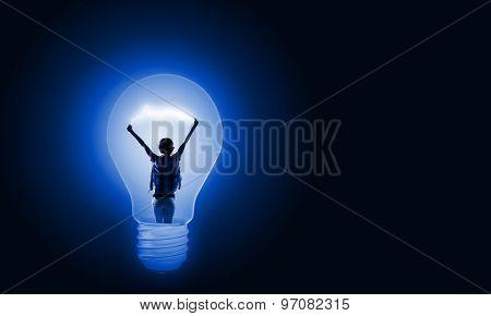 Back view of girl inside of light bulb