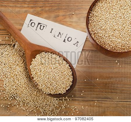 Quinoa Seed Closeup  In A Old Wooden Spoon.