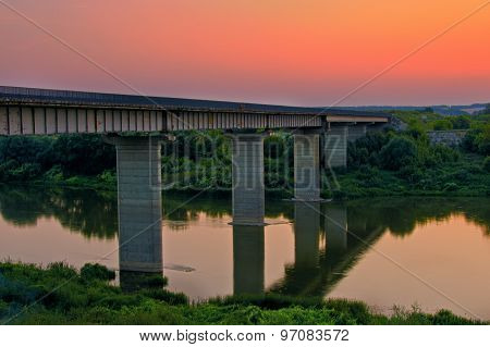 Sunset at the river with a bridge