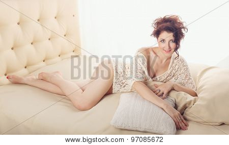 Sexy Girl Lying On Pillows.