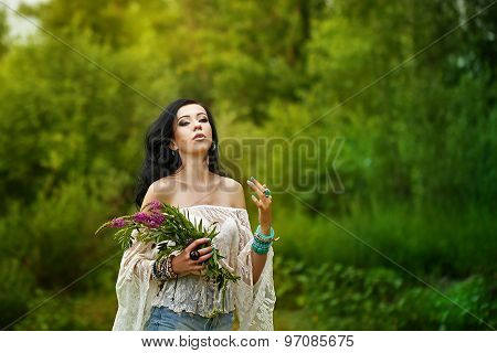 Boho Girl Holding A Bouquet Of Wildflowers.