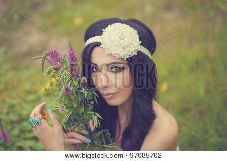 Portrait Of Girl Boho With Bouquet Of Wildflowers.