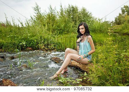 Boho Girl Sitting Barefoot On The Beach.