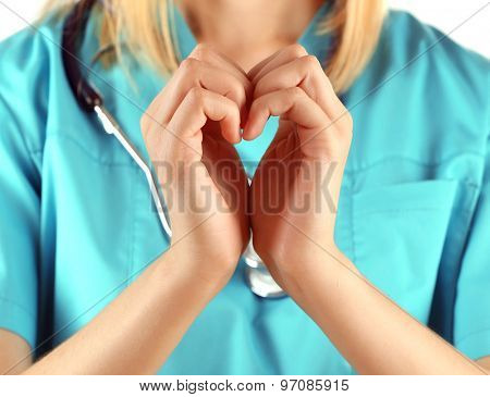 Doctor hands in shape of heart, closeup