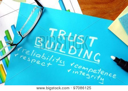 Blue paper with words trust building.