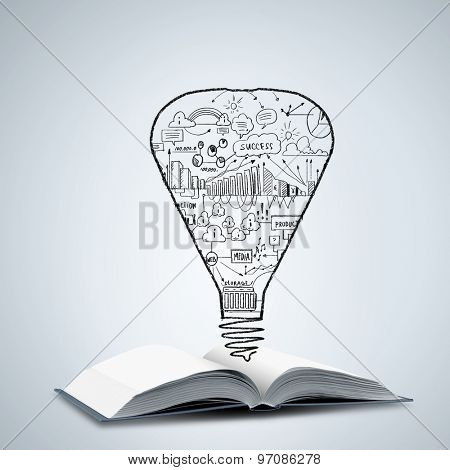 Old opened book with business sketches over white background