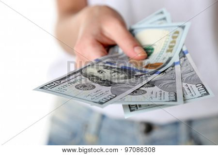 Female hand holding dollars, closeup