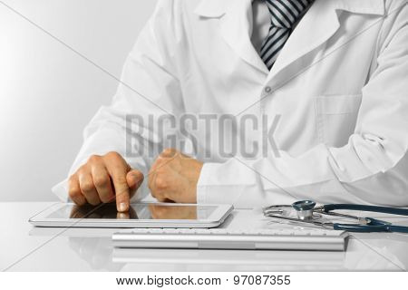 Doctor working at table close up