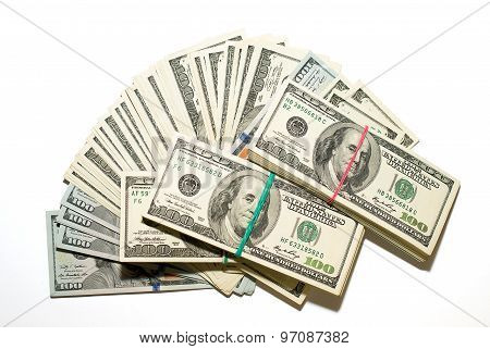 Bundles Of Us Dollars And  Banknotes On A White Background