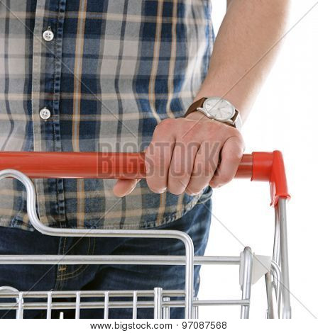 Young man with shopping cart close up