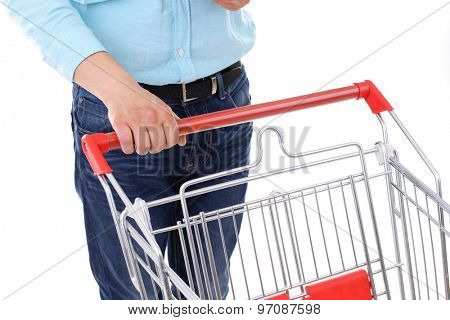 Young man with empty shopping cart close up