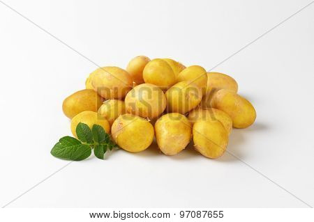 heap of baby potatoes on white background