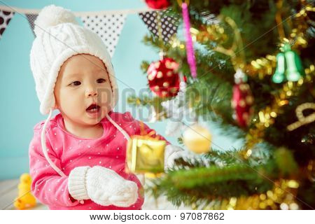 Newborn And Decorating Christmas Tree On Green Background