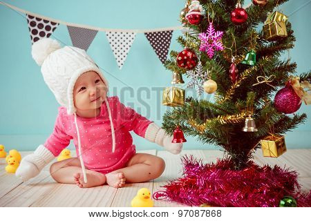 Asian Baby Girl With Christmas Tree And Gifts