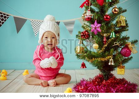Baby and  Christmas Tree With Green Background.