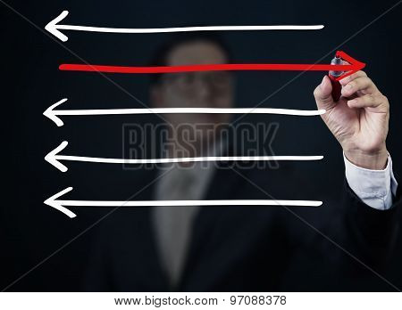 Businessman Drawing Arrows In Different Directions, Business Collection, Studio Shot