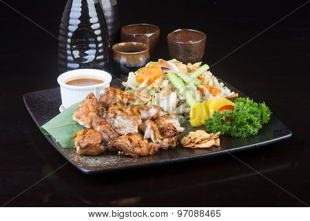 Japanese Cuisine. Grilled Chicken On The Background