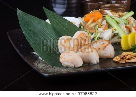 Japanese Cuisine. Grilled Shell Fish On The Background