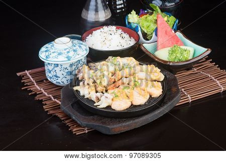 Japanese Cuisine. Hot Plate Sea Food On The Background