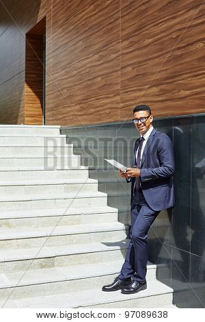 Confident businessman in formalwear looking at camera outside