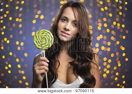Happy young female with lollipop looking at camera