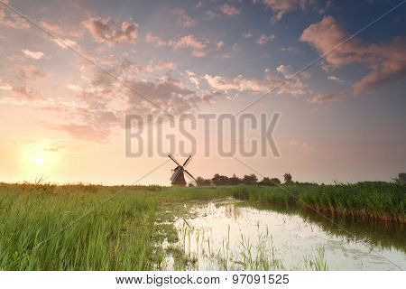 Sunrise Over Windmill By River