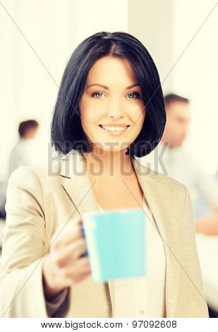 business concept - beautiful businesswoman with cup of coffee