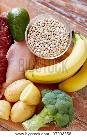balanced diet, cooking, culinary and food concept - close up of different food items on wooden table