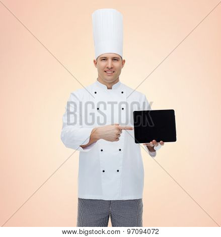 cooking, profession and people concept - happy male chef cook showing tablet pc computer black blank screen over beige background