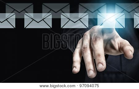 Businessman hand pressing icon of media screen