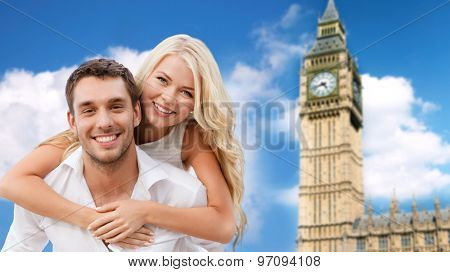 summer holidays, travel, tourism, people and dating concept - happy couple hugging over london big ben tower background