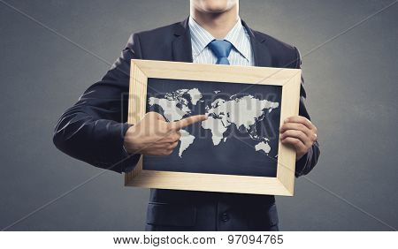 Close up of businessman holding wooden frame with world map