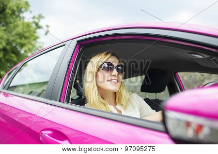 Woman in new car.