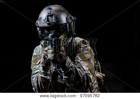 Armed Soldier In Camouflage Aiming A Rifle At You