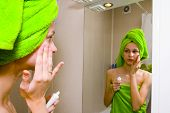 Girl Covered In Green Towel Looking In Mirror poster