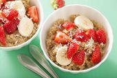 foto of quinoa  - healthy breakfast quinoa with strawberry banana coconut flakes - JPG