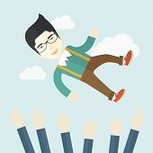 picture of throw up  - An aggressive japanese businessman being throwing up to the sky by his teamwork or colleague - JPG