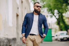 picture of macho man  - manly bearded man dressed stylishly stands on street - JPG