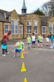 stock photo of physical education  - Group Of Children In School Physical Education Class - JPG