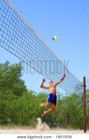 People Playing Beach Volleyball - Balding Man Strikes Ball In A Beautiful Pose