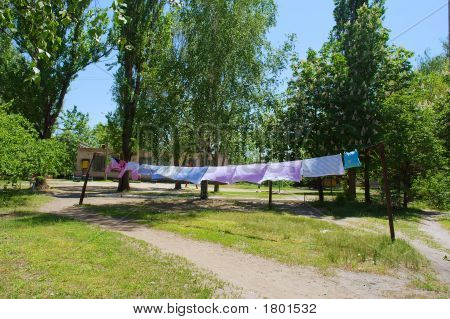 Washing Dries On Sunlight In Countryside