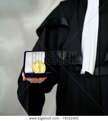 Lawyer Wearing A Robe Holdong A A Justice Meda